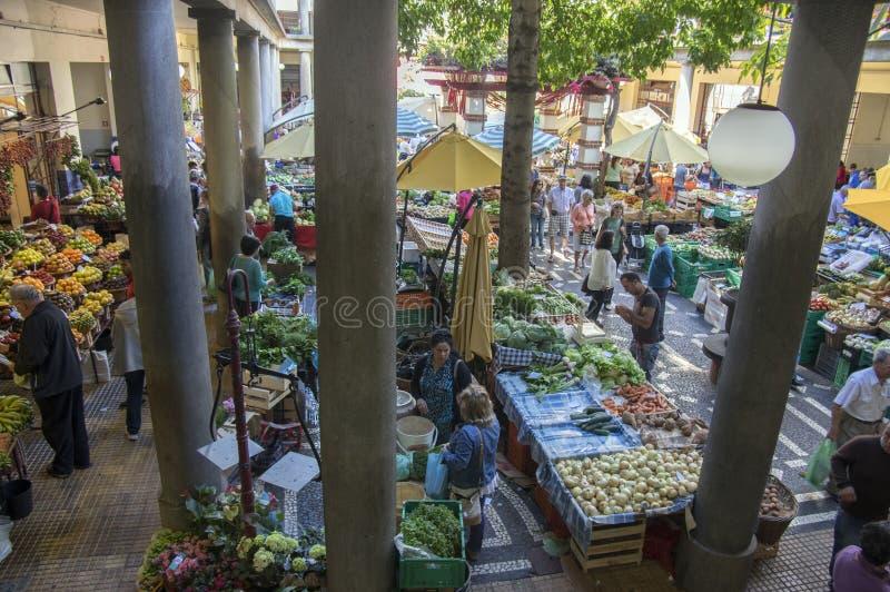 Mercado dos Lavradores fruit market, Funchal / MADEIRA - April 22, 2017: Buyers and sellers on famous Mercado dos Lavradores mar stock photo