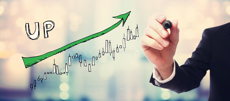 Mercato sul grafico di tendenza con l'uomo d'affari immagine stock