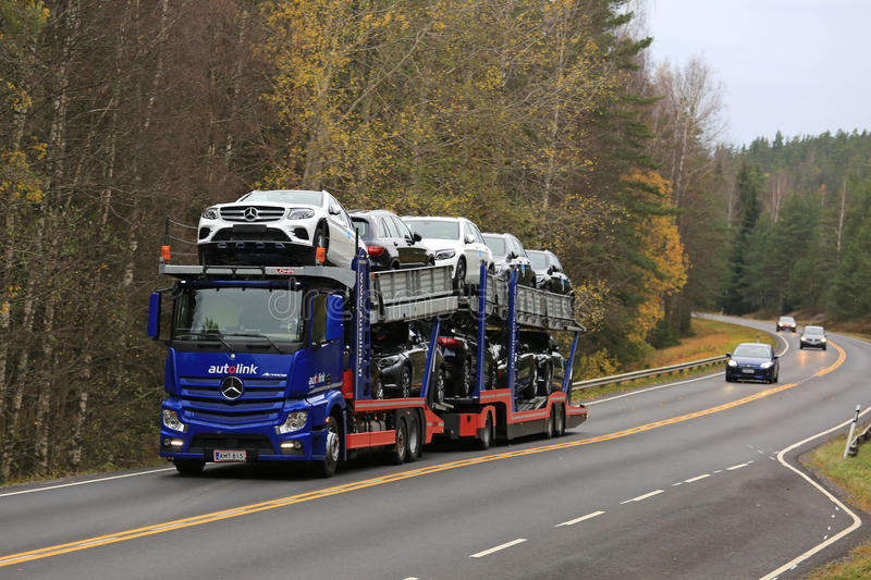 Mercedes-Benz Actros Car Carrier on the Road in Autumn. SALO, FINLAND - OCTOBER 22, 2016: Mercedes-Benz Actros car transporter hauls new Mercedes-Benz cars along stock photo