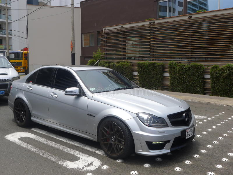 Mercedes-Benz C63 AMG in Miraflores, Lima. Lima, Peru. March 12, 2016. Mint condition silver color Mercedes-Benz C63 AMG parked in Miraflores district of Lima royalty free stock photo