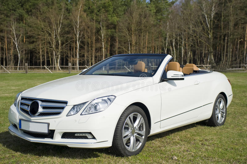 Mercedes benz cabriolet. Brand new mercedes benz cabriolet, e-class model, modern white colored with open roof, image taken outside