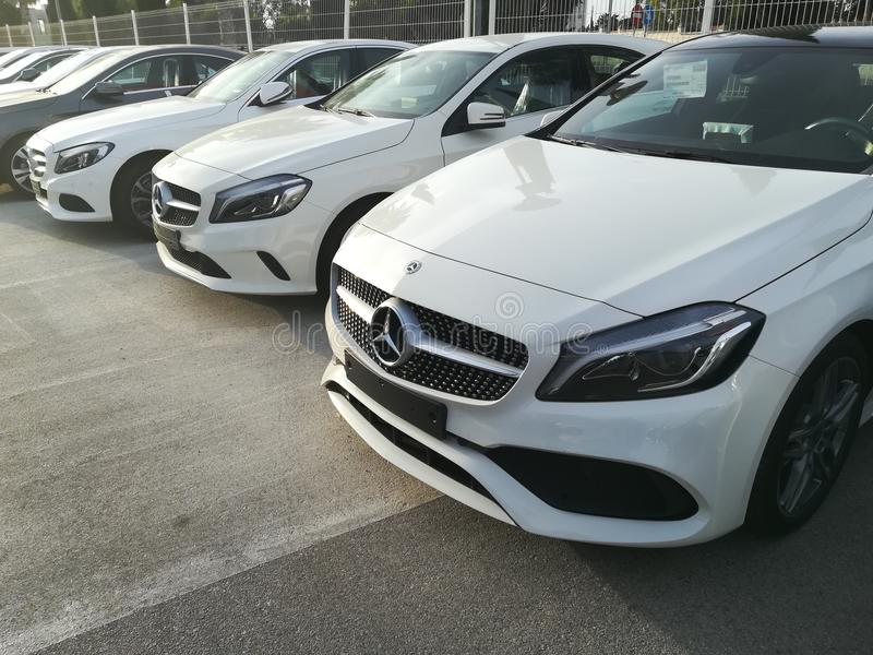 Mercedes Benz cars parked stock photography