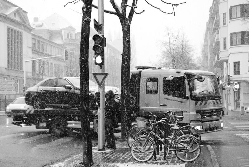 Mercedes-Benz and Citroen street accdient tow truck snowy day stock photos