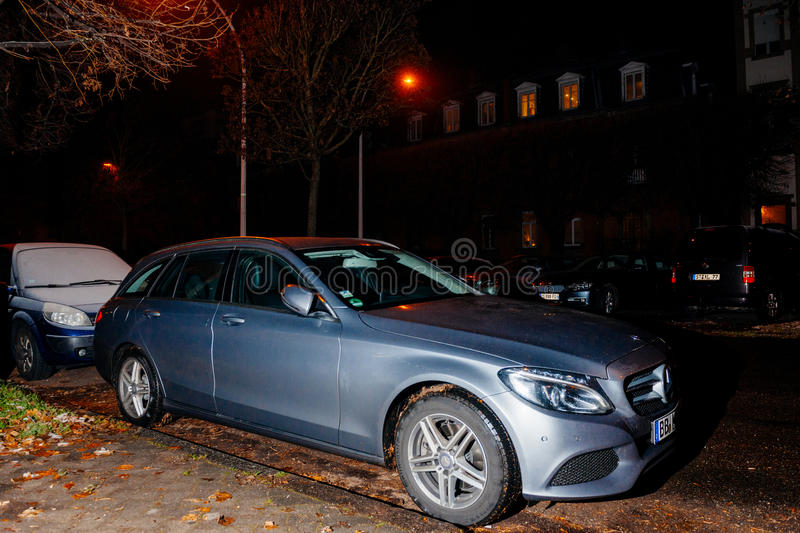 Mercedes-Benz E class car at night. STRASBOURG, FRANCE - DEC 06, 2016: German Mercedes-Benz E Class car parked for night in front of luxury French house with royalty free stock photo
