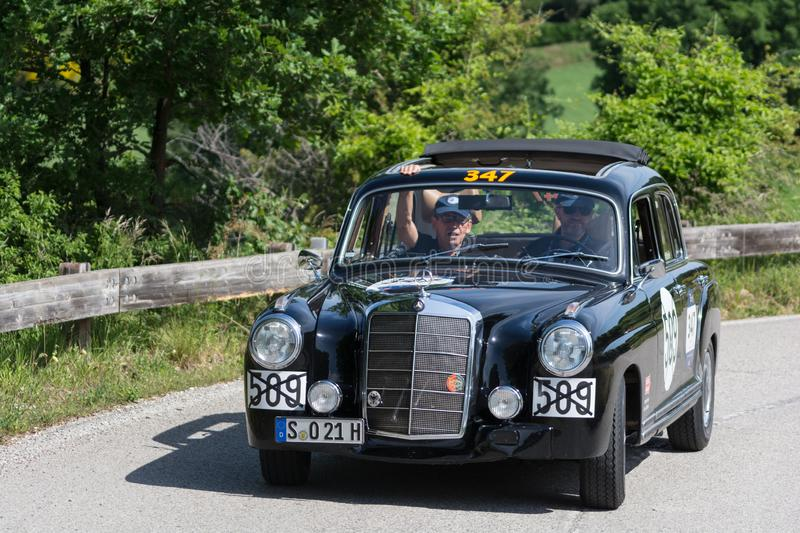 MERCEDES-BENZ 220 A 1955. PESARO COLLE SAN BARTOLO , ITALY - MAY 17 - 2018 : MERCEDES-BENZ 220 A 1955 on an old racing car in rally Mille Miglia 2018 the famous royalty free stock photography