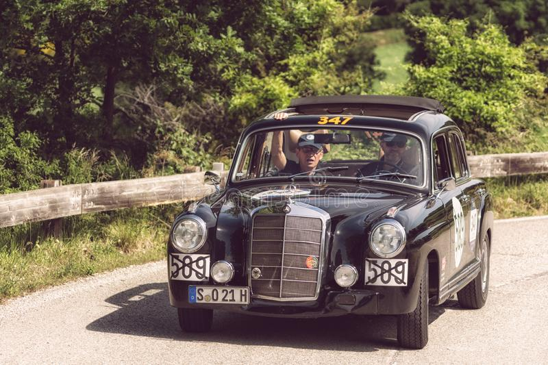 MERCEDES-BENZ 220 A 1955. PESARO COLLE SAN BARTOLO , ITALY - MAY 17 - 2018 : MERCEDES-BENZ 220 A 1955 on an old racing car in rally Mille Miglia 2018 the famous royalty free stock images