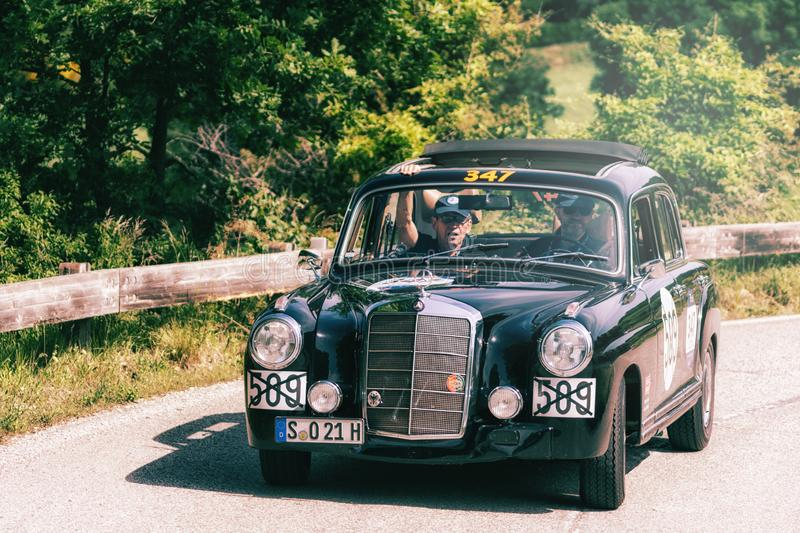 MERCEDES-BENZ 220 A 1955. PESARO COLLE SAN BARTOLO , ITALY - MAY 17 - 2018 : MERCEDES-BENZ 220 A 1955 on an old racing car in rally Mille Miglia 2018 the famous royalty free stock photos