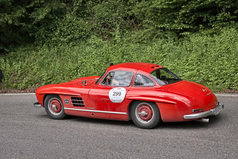Mercedes benz 300 SL W 198 in historic race Mille Miglia. Driver and co-driver on an old sports car Mercedes Benz 300 SL W 198 (1954) in rally Mille Miglia 2013 royalty free stock image