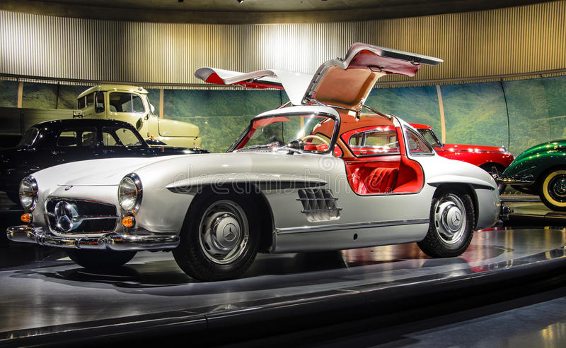 Mercedes-Benz 300SL. The Mercedes-Benz 300SL (W198) was the first iteration of the SL-Class grand tourer and fastest production car of its day. Introduced in stock images