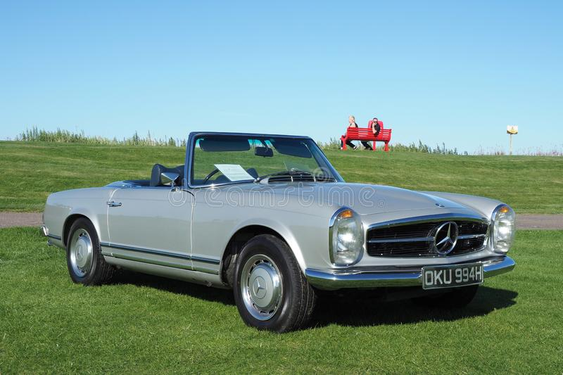 Mercedes Benz, W113, SL280 Roadster, side view. Metallic grey silver, Mercedes Benz, W113, SL280 Roadster convertible built in 1970. Made from 1967 to 1971 royalty free stock image