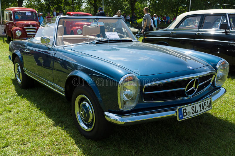 The Mercedes-Benz W113 is a two-seat roadster. PAAREN IM GLIEN, GERMANY - MAY 19: The Mercedes-Benz W113 is a two-seat roadster, introduced at the 1963 Geneva stock images