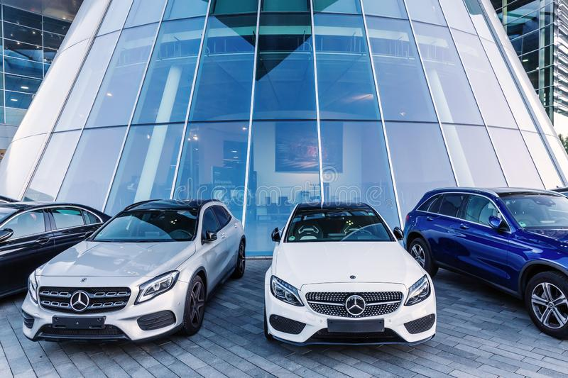 Mercedes cars in front of the Mercedes Benz headquarters stock image
