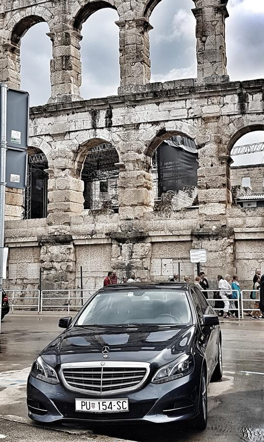 Mercedes eclass w212 at arena in pula. Luxury car mercedes in front of amphitheater in pula, istria, croatia waiting for vip clients royalty free stock images