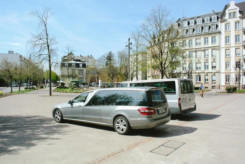 Mercedes hearse parked in front of the church stock photography