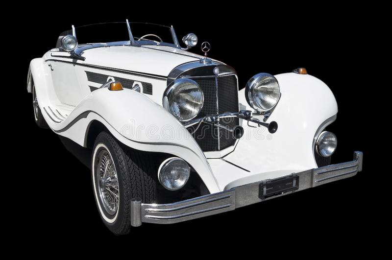 1934 Mercedes roadster cutout. White ghost car lurching forwards into night. circa 1934 German mercedes benz roadster Vakuumröhre war steel and forge royalty free stock photo