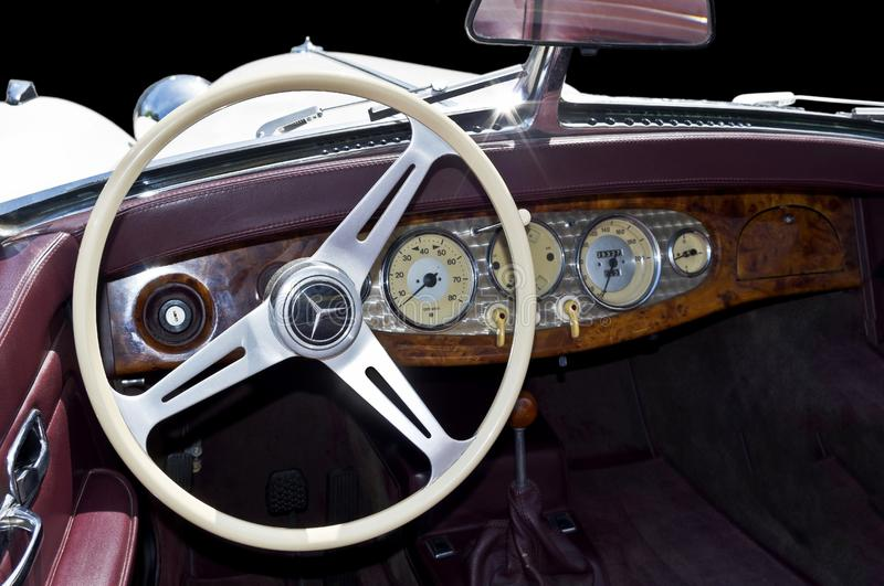 Mercedes roadster drivers side dashboard interior. Dashboard interior of period piece nineteen thirties german car resembling vacume tube dials and switches of stock photos