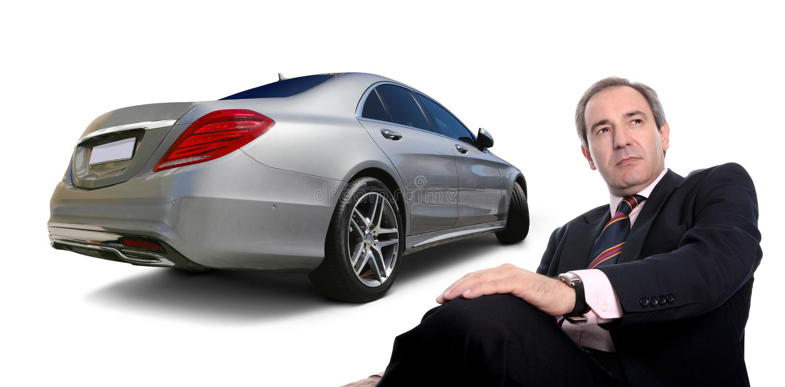 Business success. Business man with Mercedes S class car back view. Success concept stock photography