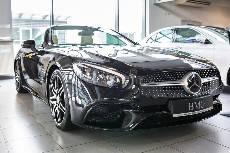 Mercedes SL63 AMG cabrio in the car showroom. GDANSK, POLAND - JANUARY 30, 2017: Brand new 2017 model of Mercedes SL63 AMG cabrio in the car showroom of Gdansk royalty free stock image