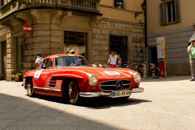 Mercedes 300 SL at Mille Miglia 2016. A Mercedes 300 SL Gullwing 1955 passing through Tasso street Bergamo, Italy before the crowd during the 2016 Mille Miglia stock image