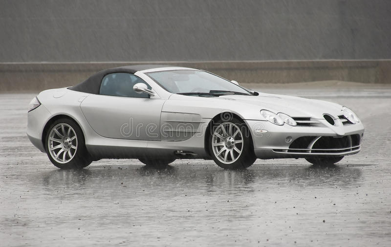 Mercedes Slr. Standing out in the rain - No Trademark stock image