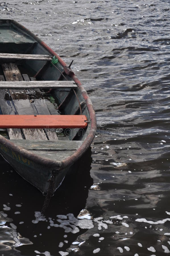 Mercedez, uruguay. An old boat is seen in the black river of Mercedez, Uruguay royalty free stock photography