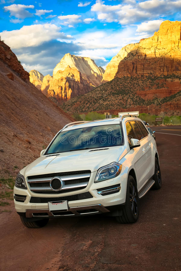 Merceds benz ML. Mercedes benz ML in pearl white parked in front of Zion National Park entrance royalty free stock image