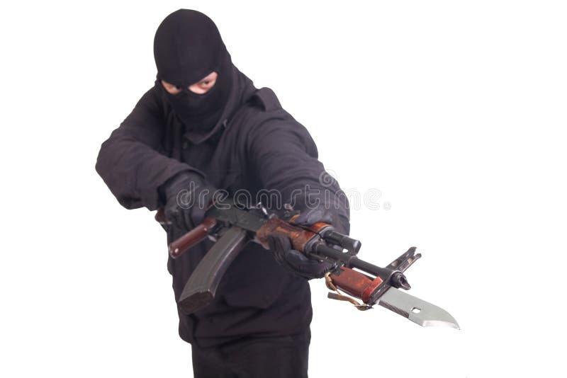 Mercenary with AK 47 gun witn bayonet stock photography