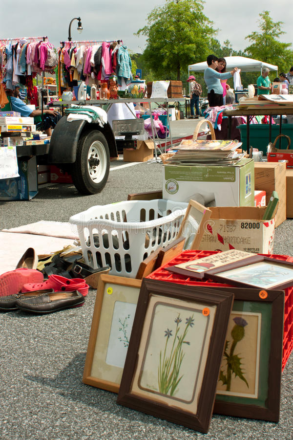 Merchandise On Display At Citywide Garage Sale. LILBURN, GA - APRIL 21: Unidentified shoppers look over the merchandise being sold at the Lilburn citywide garage royalty free stock photography