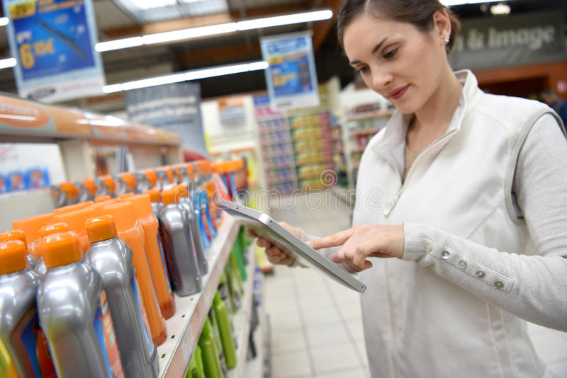 Merchandiser at store making inventory royalty free stock image
