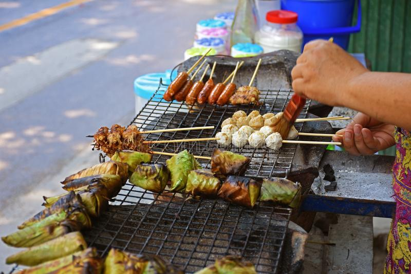 Merchant are grilled meet ball and meet stick on street road.  stock image