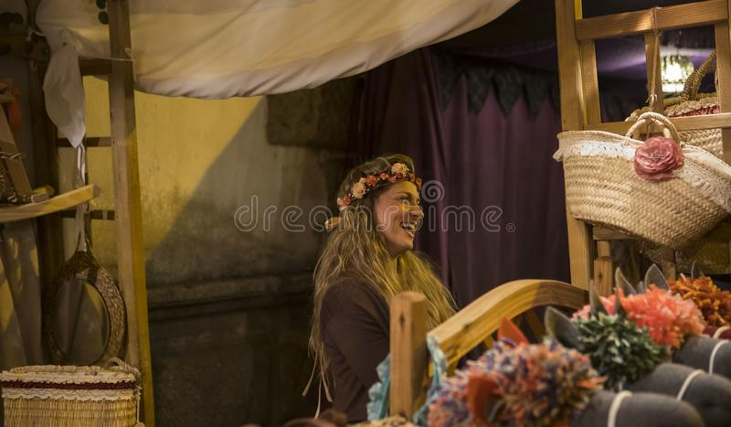 Braga, Portugal - May 24, 2019: Merchant roman woman at Braga Romana royalty free stock image