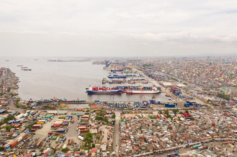 Merchant ships and cargo containers. Sea port in Manila, February 2019. Landscape, view from above stock photography