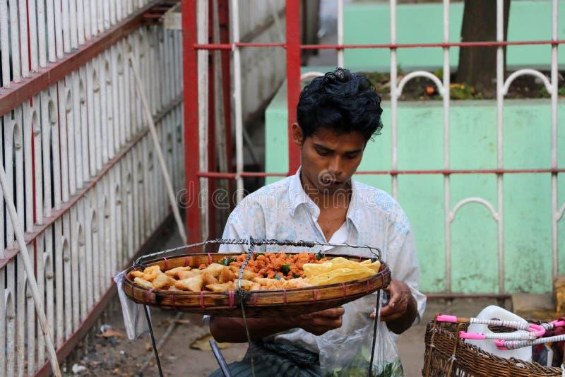 Merchants selling fried food in front of Bogyoke Aung San Market or scott market, Yangon stock photo