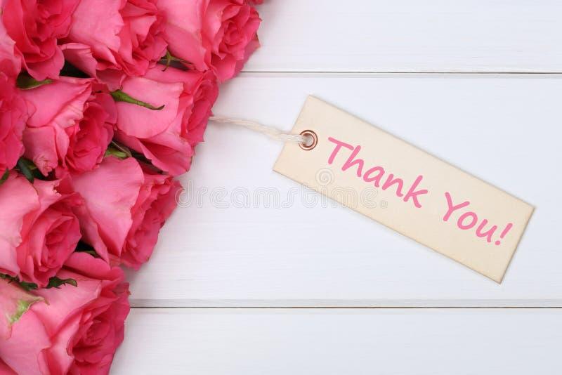 Merci avec des fleurs de roses la mère ou la Saint-Valentin photos libres de droits