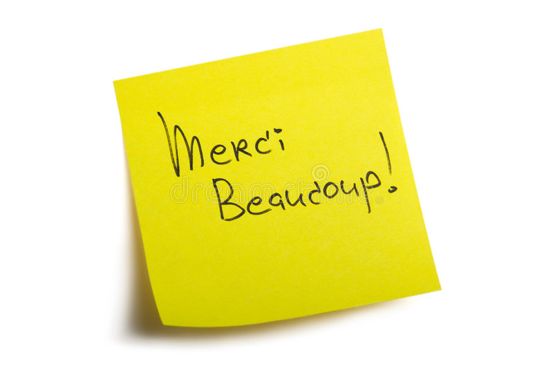 Merci Beaucoup!. Sticky note. Isolated on white background with clipping path royalty free stock images