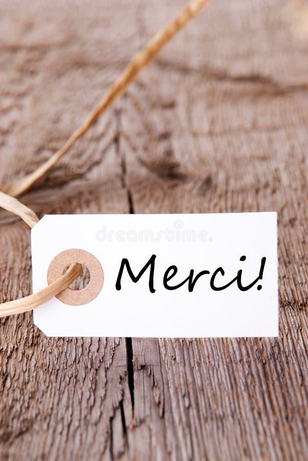 Merci etikett på trä fotografering för bildbyråer
