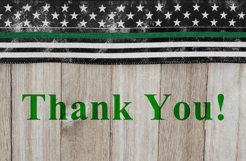Merci message sur un drapeau mince américain de Ligne Verte des agents de patrouille de frontière photo stock