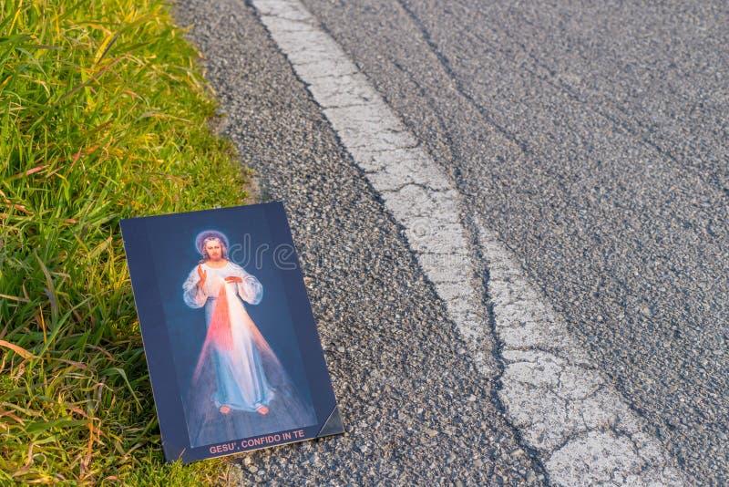 Merciful Jesus icon on dirt asphalt road royalty free stock photography