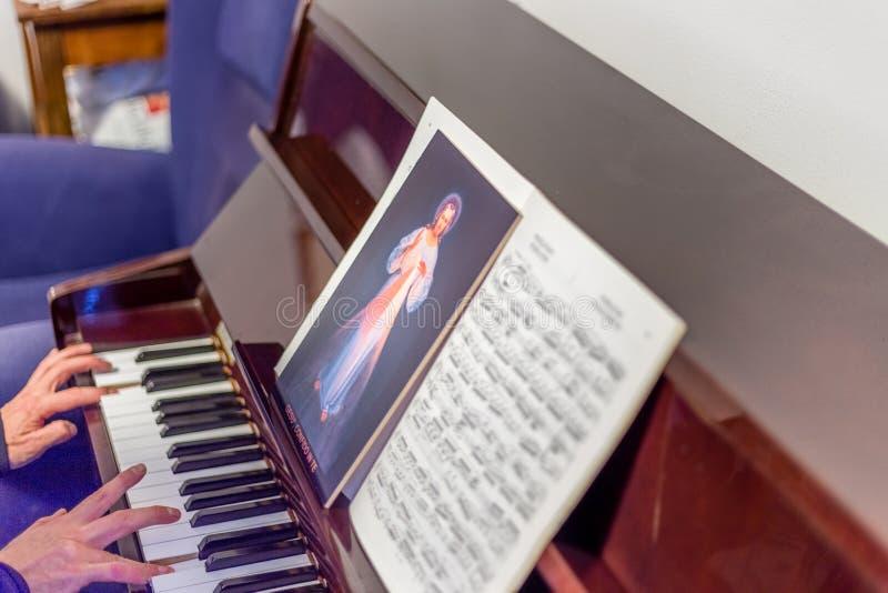 Merciful Jesus icon on scores stock image