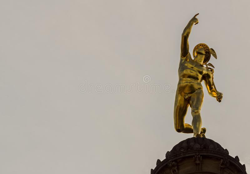 This is a mercury pillar statue on the Schlossplatz royalty free stock photos