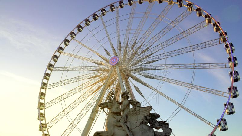 Mercury riding Pegasus marble statue and giant Ferris wheel in Tuileries Garden royalty free stock photography