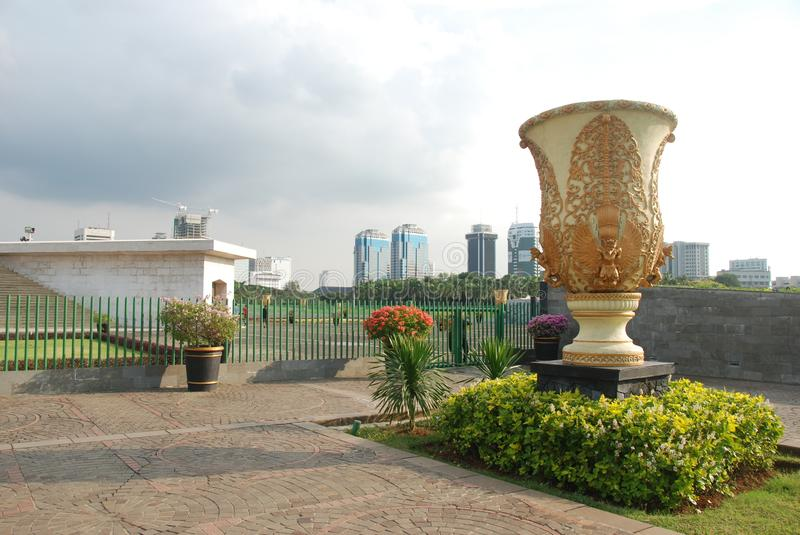 Merdeka Square of Jakarta. Park and gardens of Merdeka Square in Central Jakarta, Indonesia with modern skyscrapers in the background royalty free stock image