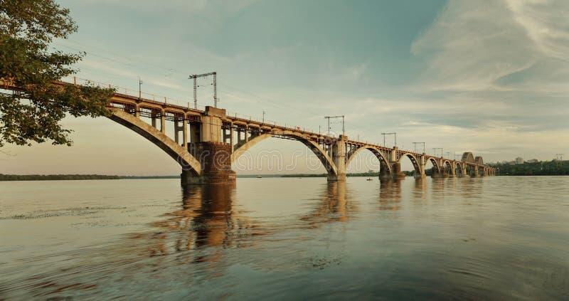 `Merefa-Kherson` railroad bridge. `Merefa-Kherson` railway bridge across the Dnieper River in Dnepropetrovsk Ukraine, urban landscape royalty free stock images