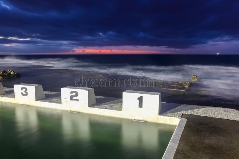 Merewether Ocean Baths - Iconic Starting Blocks at Sunrise. The Merewether Ocean Baths and their ocean side starting blocks are an iconic part of Newcastle`s royalty free stock images