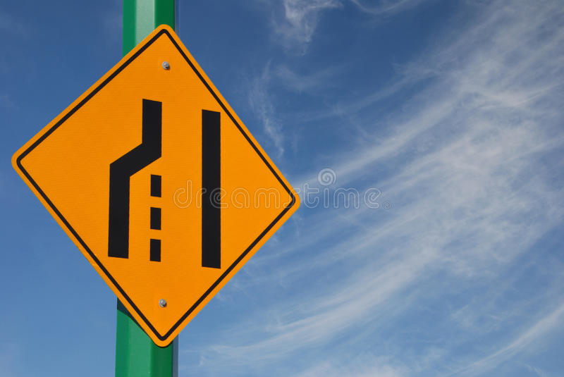 Merge left traffic sign royalty free stock photo
