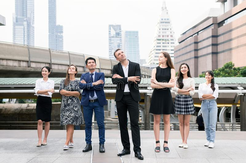 Mergers and acquisition,Successful group of business diversity people,Team success achievement hand cross arms over blurred buildi stock images