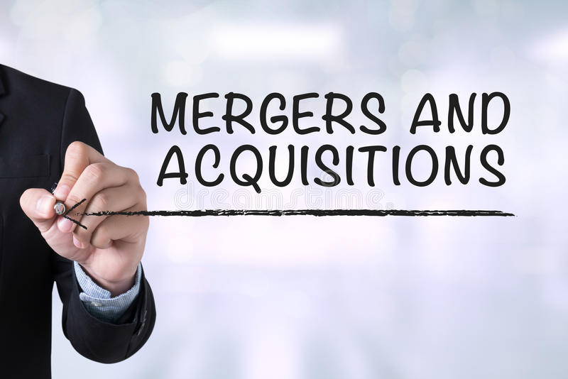 MERGERS AND ACQUISITIONS M&A royalty free stock image