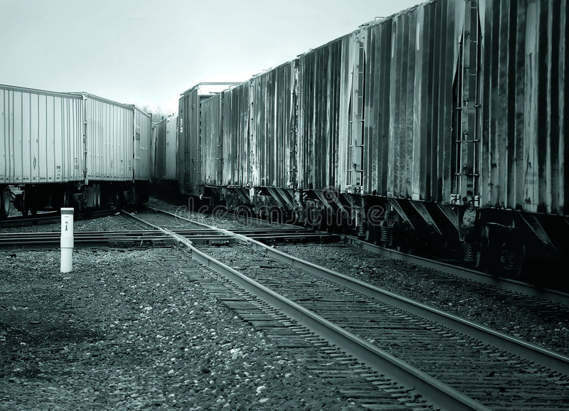 Merging Trains In Blue Tone Royalty Free Stock Photos