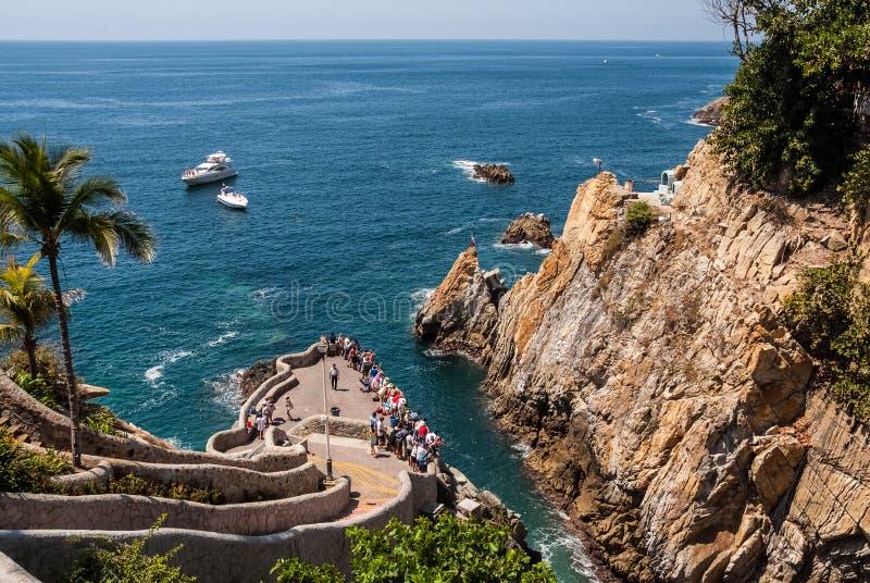 Mergulhadores do penhasco de Quebrada Acapulco do La foto de stock