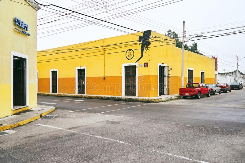Merida / Yucatan, Mexico - June 1, 2015: The traffic corner with colorful yellow building in background in the city of Merdia, Yuc stock photos